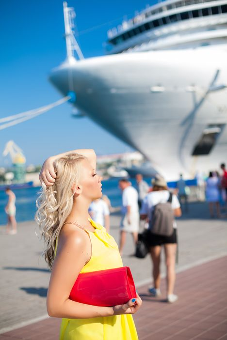 Lady standing in front of a Princess Cruises ship