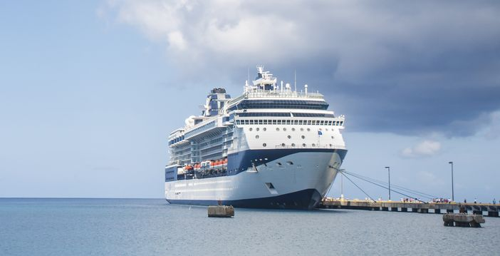 Celebrity Cruises ship docked at a pier