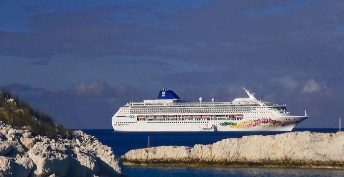 Norwegian Sky anchored at NCL's private island
