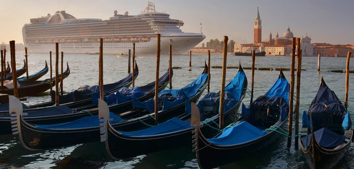 Gondolas and arriving cruise ship in Venice