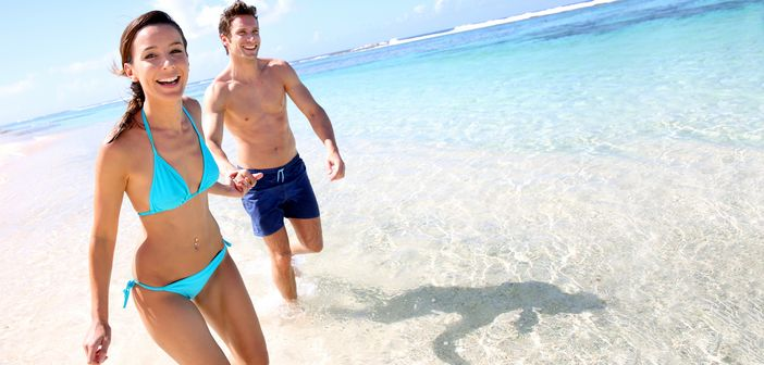 Lovers enjoy each other's company in the crystal clear water of Seychelles