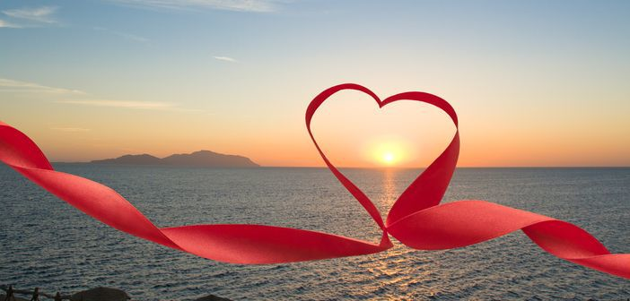 Honeymoon on a Cruise - Red ribbon shaping a heart around the sun
