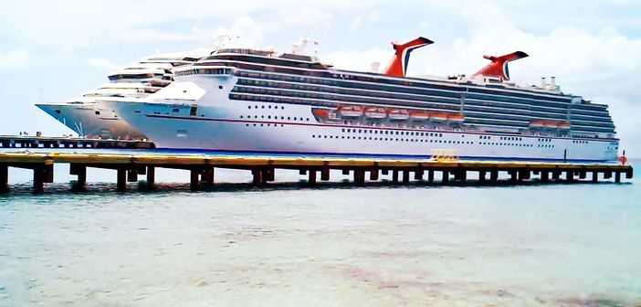 2 Carnival cruise ships docked at Cozumel's pier