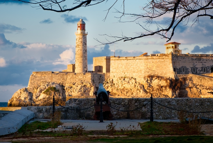 The fortress and lighthouse of El Morro, a symbol of Havana at sunset