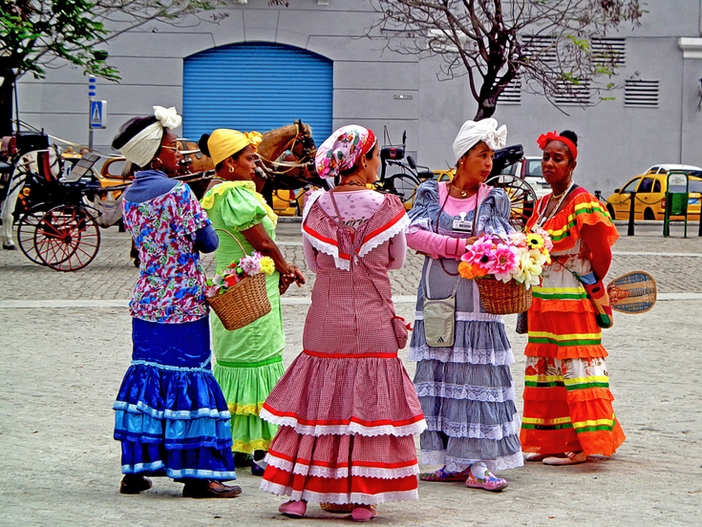 Women in colorful dresses in Havana