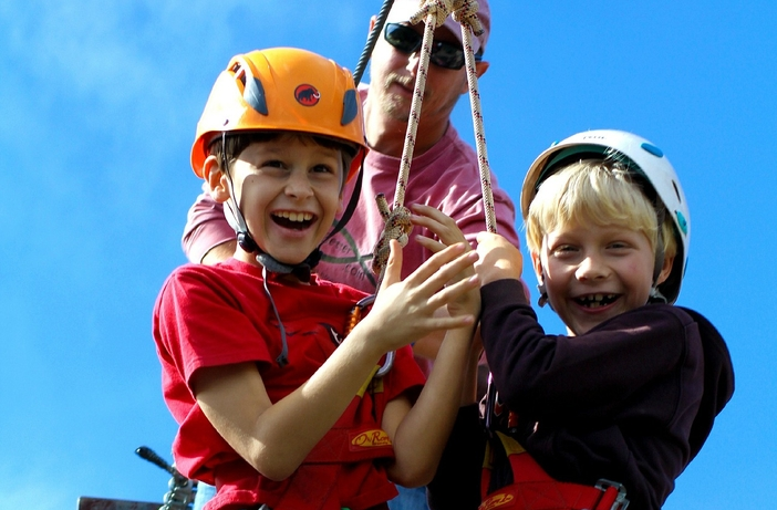 Happy kids trying out the zip lining