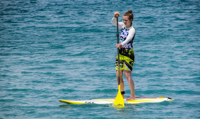 Young lady paddle boarding