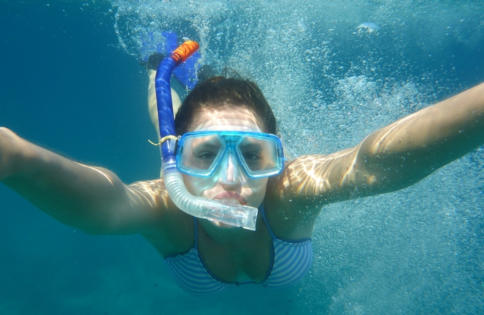 Young lady enjoys snorkeling