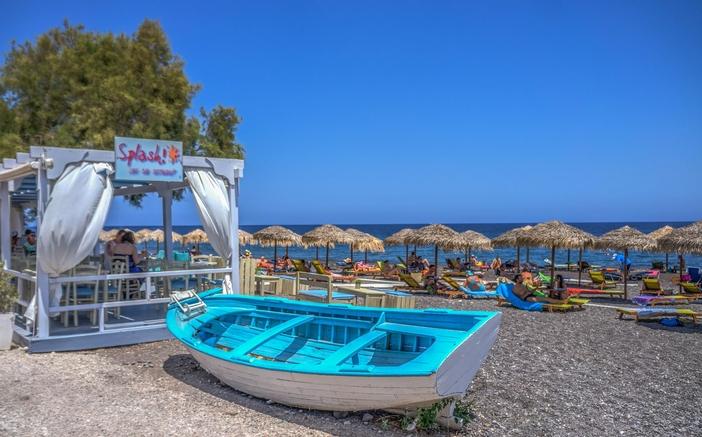 Relax on the Kamari Beach in Santorini